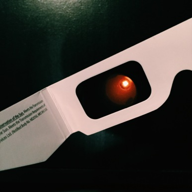 Light through solar eclipse glasses